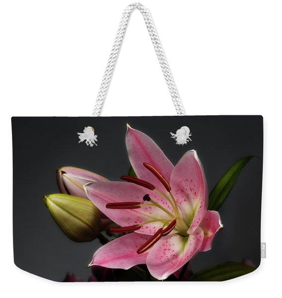Blossoming Pink Lily Flower On Dark Background Weekender Tote Bag