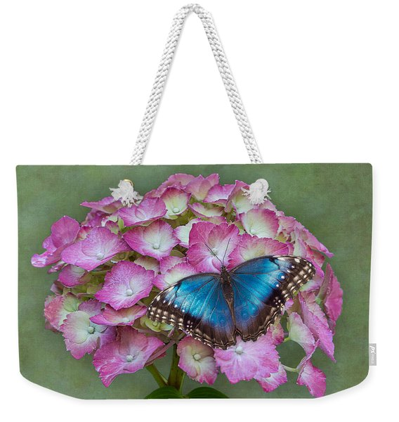 Weekender Tote Bag featuring the photograph Blue Morpho Butterfly On Pink Hydrangea by Patti Deters