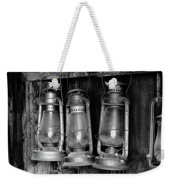 Weekender Tote Bag featuring the photograph Bodie Lanterns by Tom Singleton