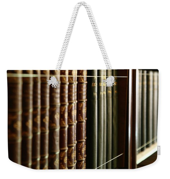 Weekender Tote Bag featuring the photograph Books by Michael Hope