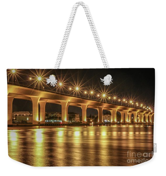 Weekender Tote Bag featuring the photograph Bridge And Golden Water by Tom Claud