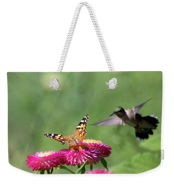 Weekender Tote Bag featuring the photograph Butterfly Vs Hummingbird 1 by Brian Hale