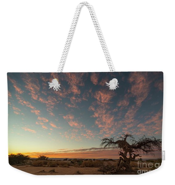 Weekender Tote Bag featuring the photograph Bye Bye To Sunset by Arik Baltinester