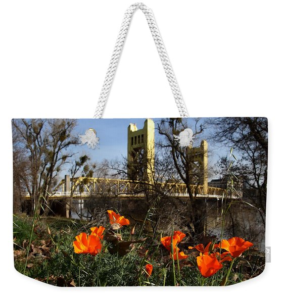 California Poppies With The Slightly Photographically Blurred Sacramento Tower Bridge In The Back Weekender Tote Bag