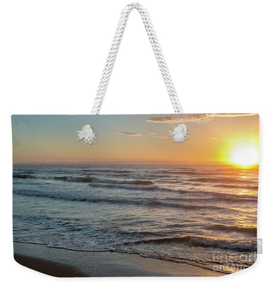 Calm Water Over Wet Sand During Sunrise Weekender Tote Bag