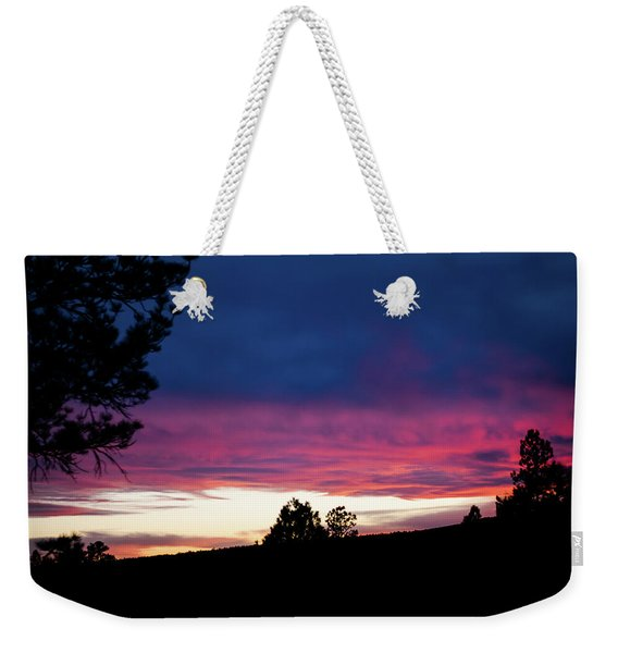 Weekender Tote Bag featuring the photograph Candy-coated Clouds by Jason Coward