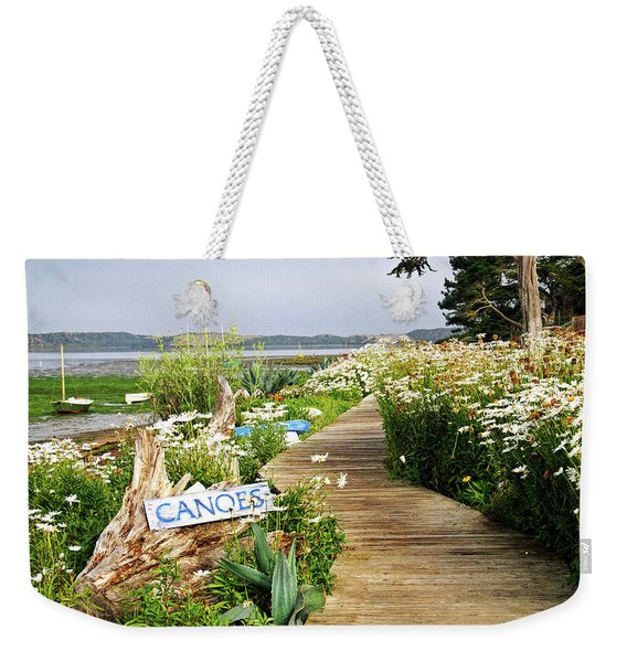 Weekender Tote Bag featuring the photograph Canoes By Mike-hope by Michael Hope