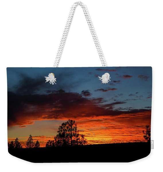 Weekender Tote Bag featuring the photograph Canvas For A Setting Sun by Jason Coward