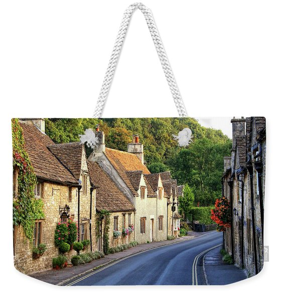 Weekender Tote Bag featuring the photograph Castle Combe High Street by Michael Hope