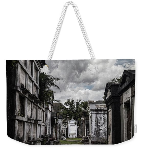 Weekender Tote Bag featuring the photograph Cemetery Row by Laura Roberts