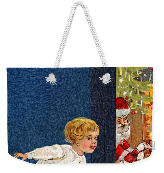 Child Listens As Santa Places Gifts By The Tree On Christmas Eve Weekender Tote Bag