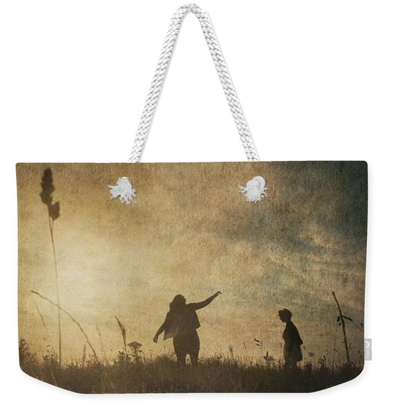 Weekender Tote Bag featuring the photograph Children Playing by Clayton Bastiani