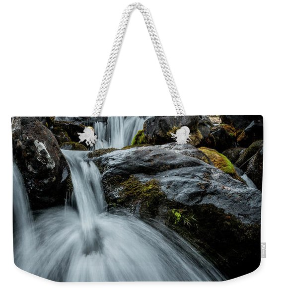 Weekender Tote Bag featuring the photograph Chilly Spring Shower by Tim Newton