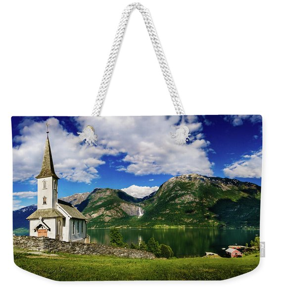 Weekender Tote Bag featuring the photograph Church And Waterfall by Dmytro Korol