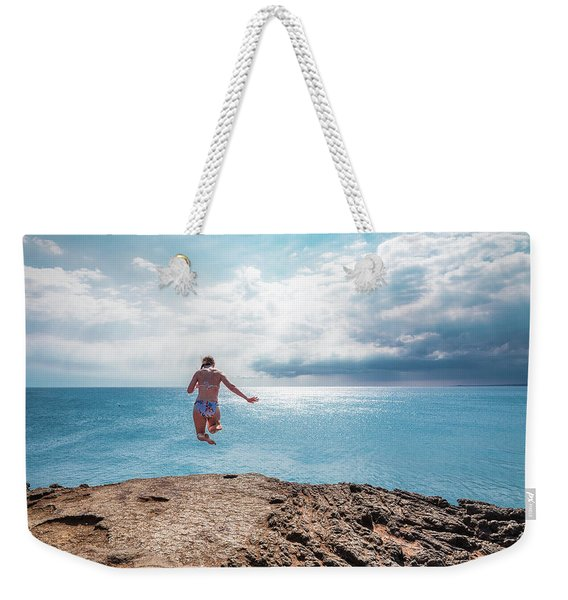 Weekender Tote Bag featuring the photograph Cliff Jumping by Break The Silhouette