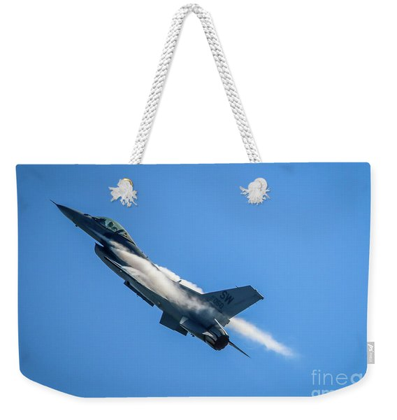 Weekender Tote Bag featuring the photograph Climbing Falcon by Tom Claud