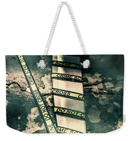 Closeup Of Knife Wrapped With Do Not Cross Tape On Floor Weekender Tote Bag