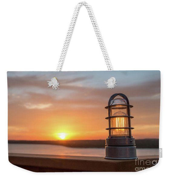 Closeup Of Light With Sunset In The Background Weekender Tote Bag