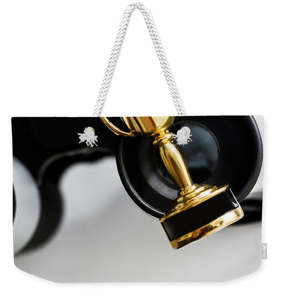 Closeup Of Small Trophy And Binoculars On White Background Weekender Tote Bag