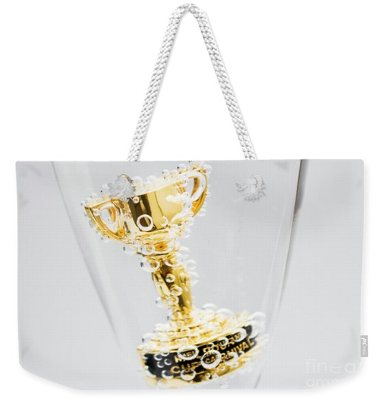 Closeup Of Small Trophy In Champagne Flute. Gold Colored Award I Weekender Tote Bag