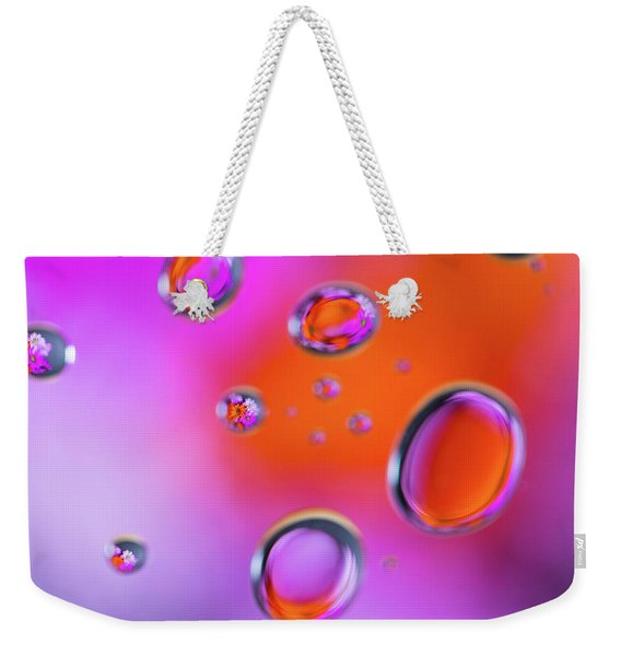 Weekender Tote Bag featuring the photograph Color Drops by Brian Hale