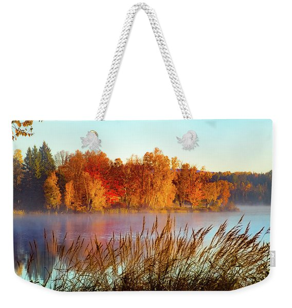 Weekender Tote Bag featuring the photograph Colorful Dawn On Haley Pond by Jeff Folger