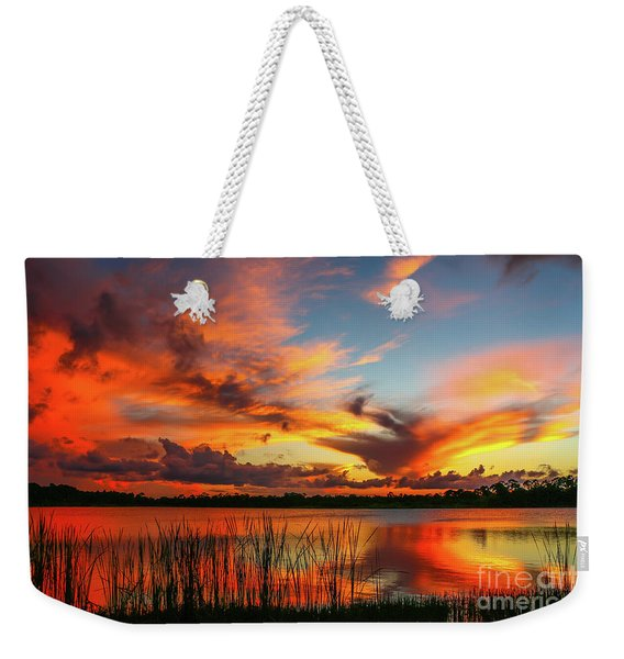 Weekender Tote Bag featuring the photograph Colorful Fort Pierce Sunset by Tom Claud
