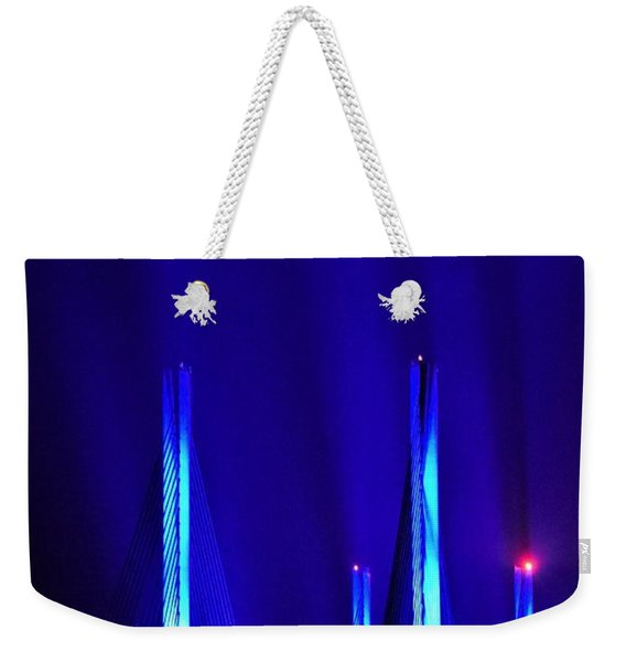 Weekender Tote Bag featuring the photograph Blue Light Rays - Indian River Inlet Bridge by Kim Bemis