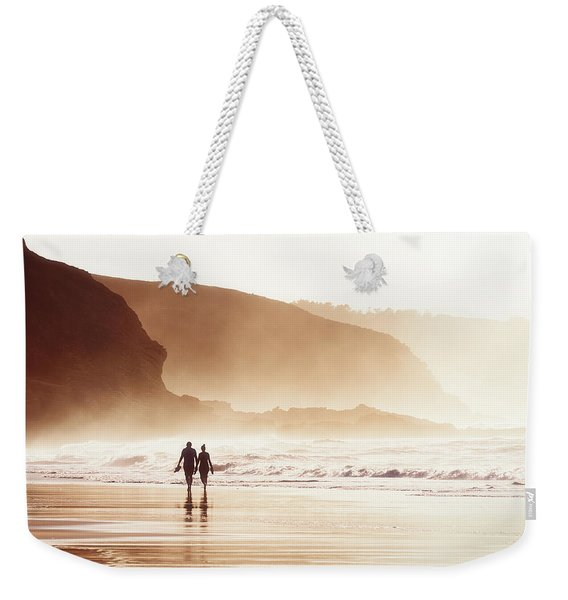 Couple Walking On Beach With Fog Weekender Tote Bag