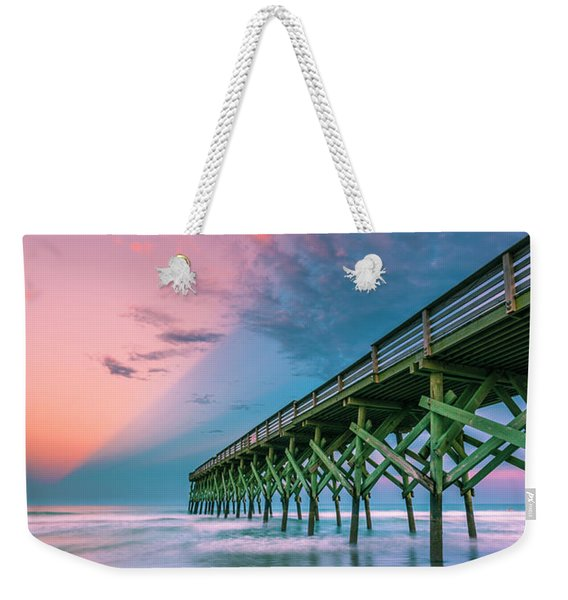 Weekender Tote Bag featuring the photograph Crystal Beach Pier Sunset In North Carolina by Ranjay Mitra