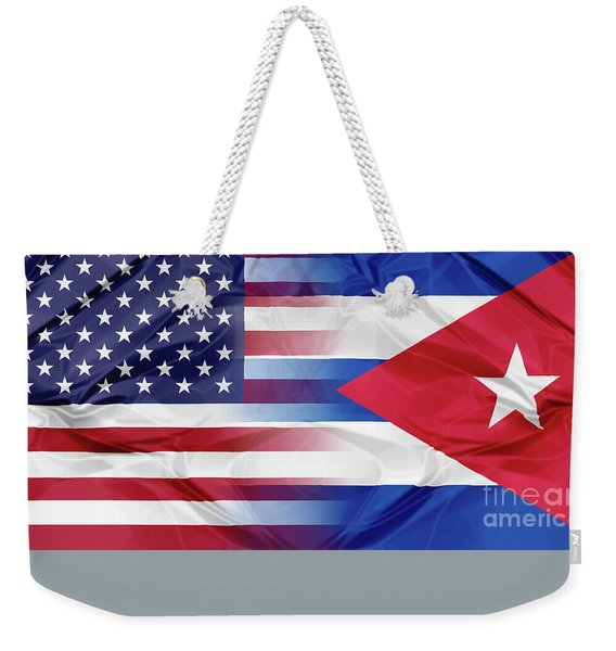 Weekender Tote Bag featuring the photograph Cuba And Usa Flags by Benny Marty