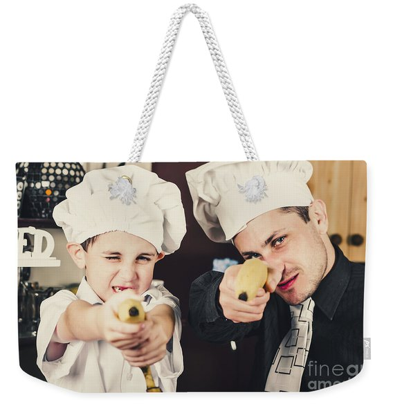 Dad And Son Cooks Shooting With Bananas In Kitchen Weekender Tote Bag