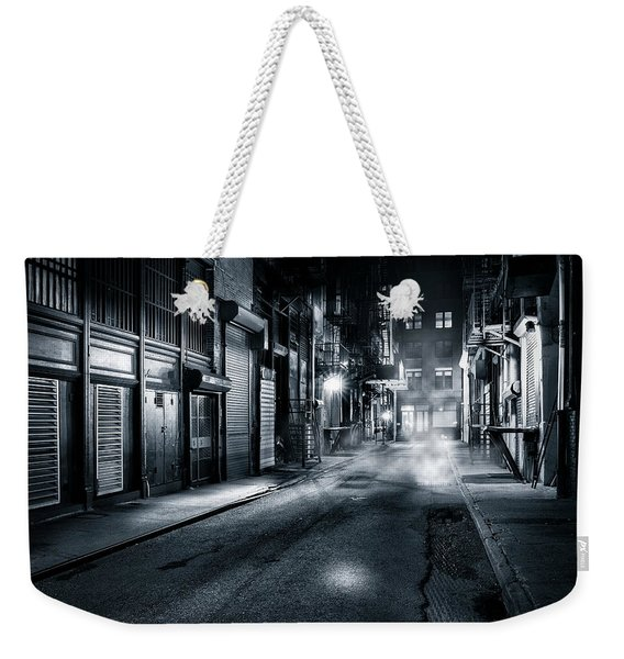 Weekender Tote Bag featuring the photograph Dark Nyc by Mihai Andritoiu