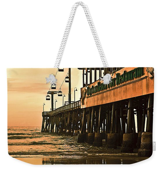 Weekender Tote Bag featuring the photograph Daytona Beach Pier by Carolyn Marshall