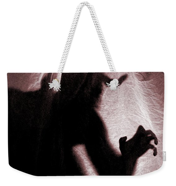 Weekender Tote Bag featuring the photograph Demon by Clayton Bastiani