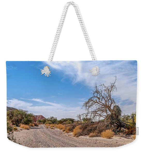 Weekender Tote Bag featuring the photograph Desert Road by Arik Baltinester