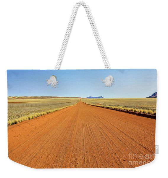 Weekender Tote Bag featuring the photograph Desert Road by Benny Marty