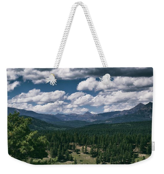 Weekender Tote Bag featuring the photograph Distant Windows by Jason Coward