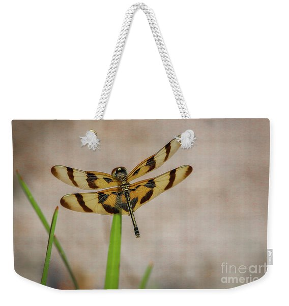 Weekender Tote Bag featuring the photograph Dragonfly On Grass by Tom Claud