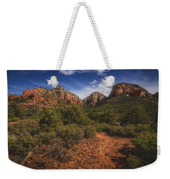 Weekender Tote Bag featuring the photograph Dramatic Cloudscape Over Capitol Butte by Andy Konieczny