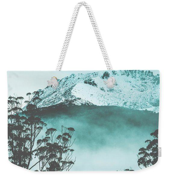 Dramatic Dark Blue Mountain With Snow And Fog Weekender Tote Bag