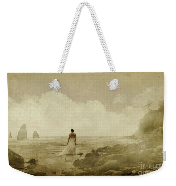 Weekender Tote Bag featuring the photograph Dramatic Seascape And Woman by Clayton Bastiani