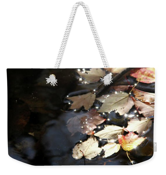 Dry Leaves Floating On The Surface Of A Stream Weekender Tote Bag