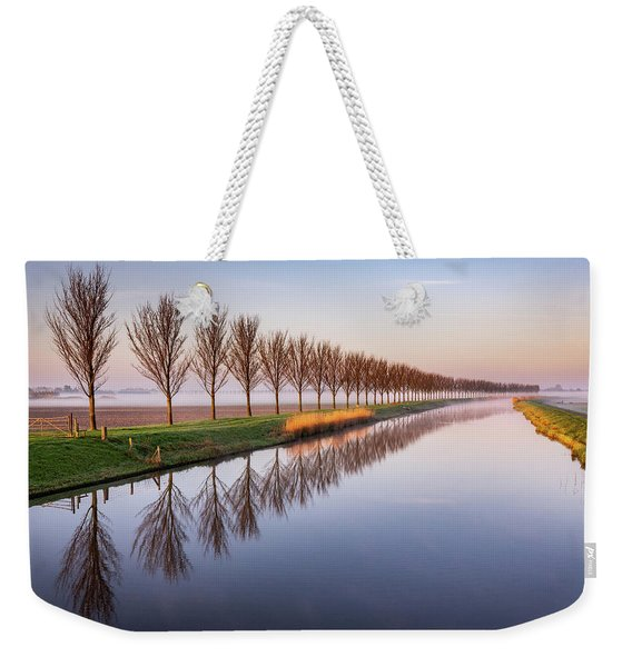 Weekender Tote Bag featuring the photograph Early Morning By The Canal by Susan Leonard