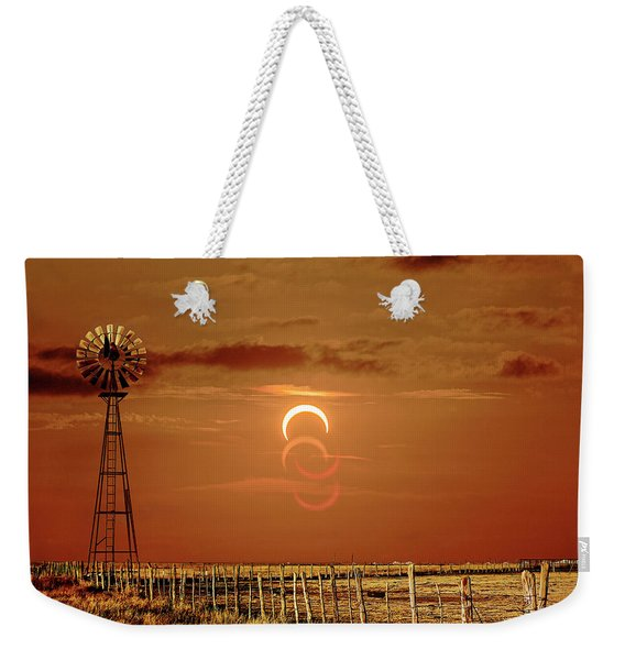 Weekender Tote Bag featuring the photograph Eclipse And Lens Flares by Scott Cordell