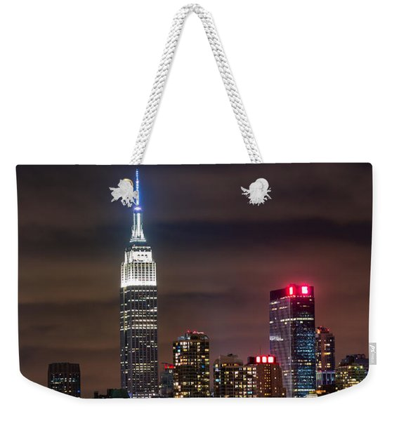 Weekender Tote Bag featuring the photograph Eclipse by Mihai Andritoiu