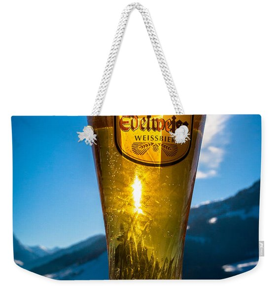 Weekender Tote Bag featuring the photograph Edelweiss Beer In Kirchberg Austria by John Wadleigh