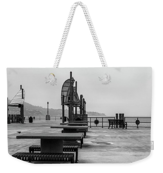 Weekender Tote Bag featuring the photograph Empty Pier by Michael Hope