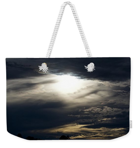Weekender Tote Bag featuring the photograph Evening Eye by Jason Coward