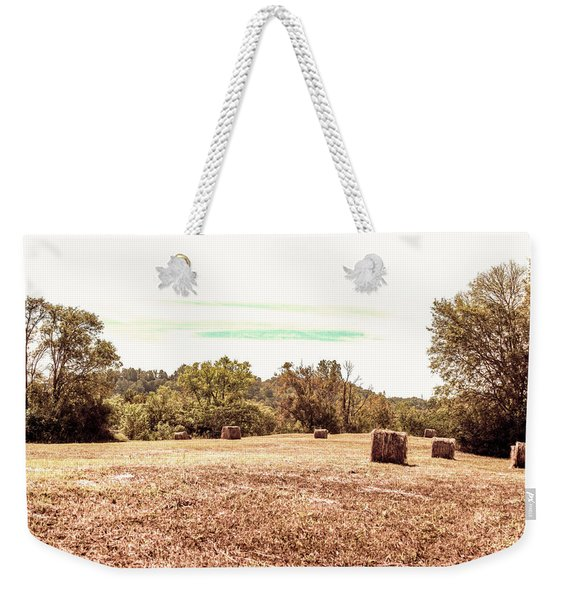 Weekender Tote Bag featuring the photograph Fall Rolls by Sally Sperry